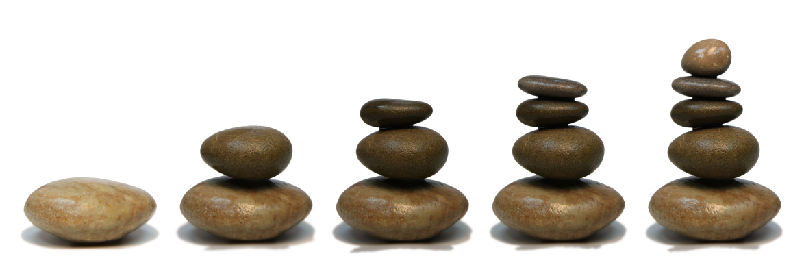 Header image of beach pebbles balanced into stacks